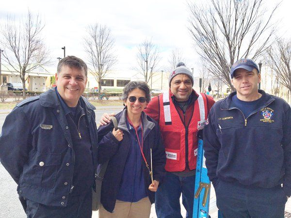 photo of firefighters, red cross, and meals on wheels folks
