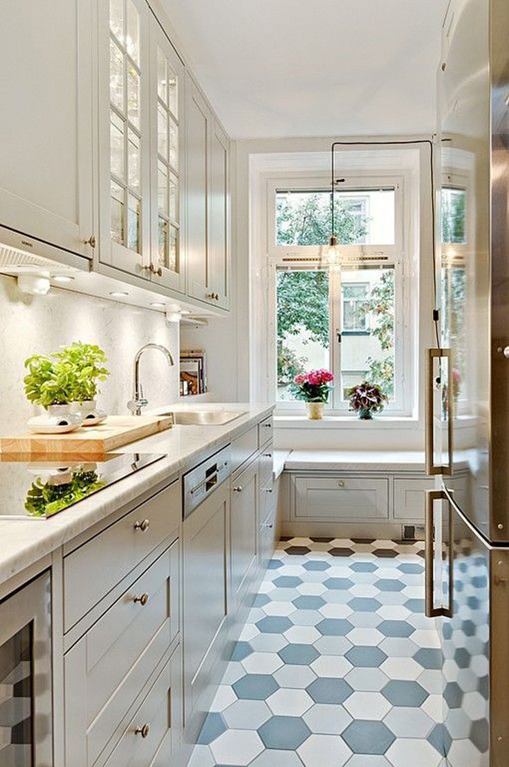 Beautiful small space design featuring colored tile cream cabinets