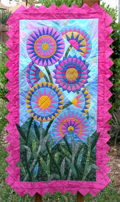 What do you know?  This is a combination of piecing and machine embroidery!