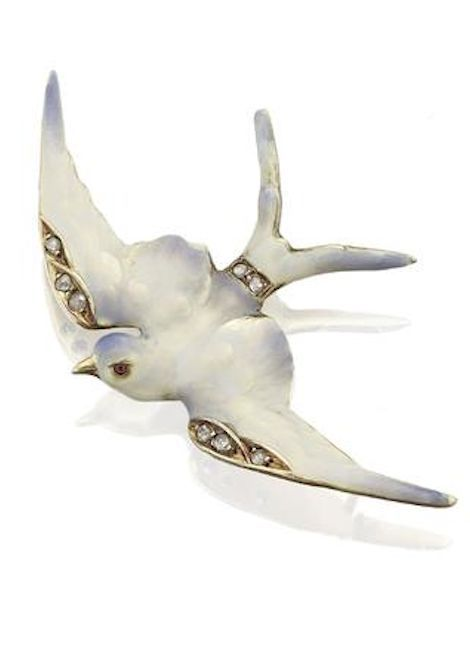 An Art Nouveau enamel and diamond swallow brooch, circa 1900 Modelled in flight, the outstretched wings in plique-à-jour enamel, the wings and tail with rose-cut diamond accents, wing span 42mm, stamped 15ct.