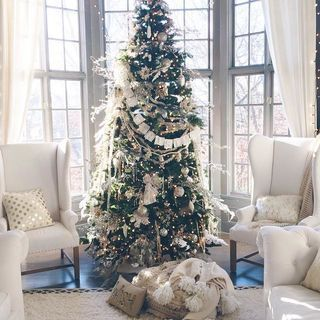 Christmas #AnthroRegistry the perfect ornaments and cozy faux fur pillows to accent the tree!