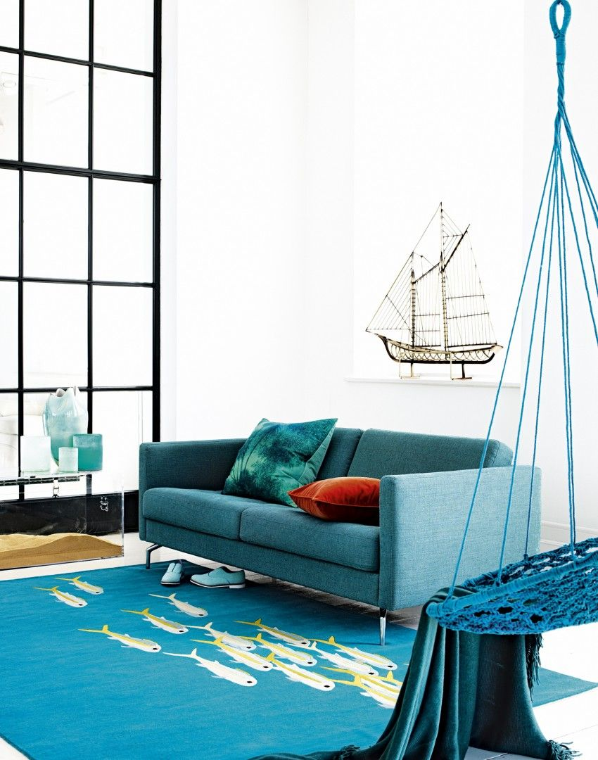 Modern White Living Room with Bold Teal Accents. Coastal style with ...