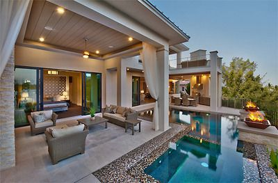7e7f9ec36 Perfect backyard patio and pool set-up. Id make the pool a little bigger  though.