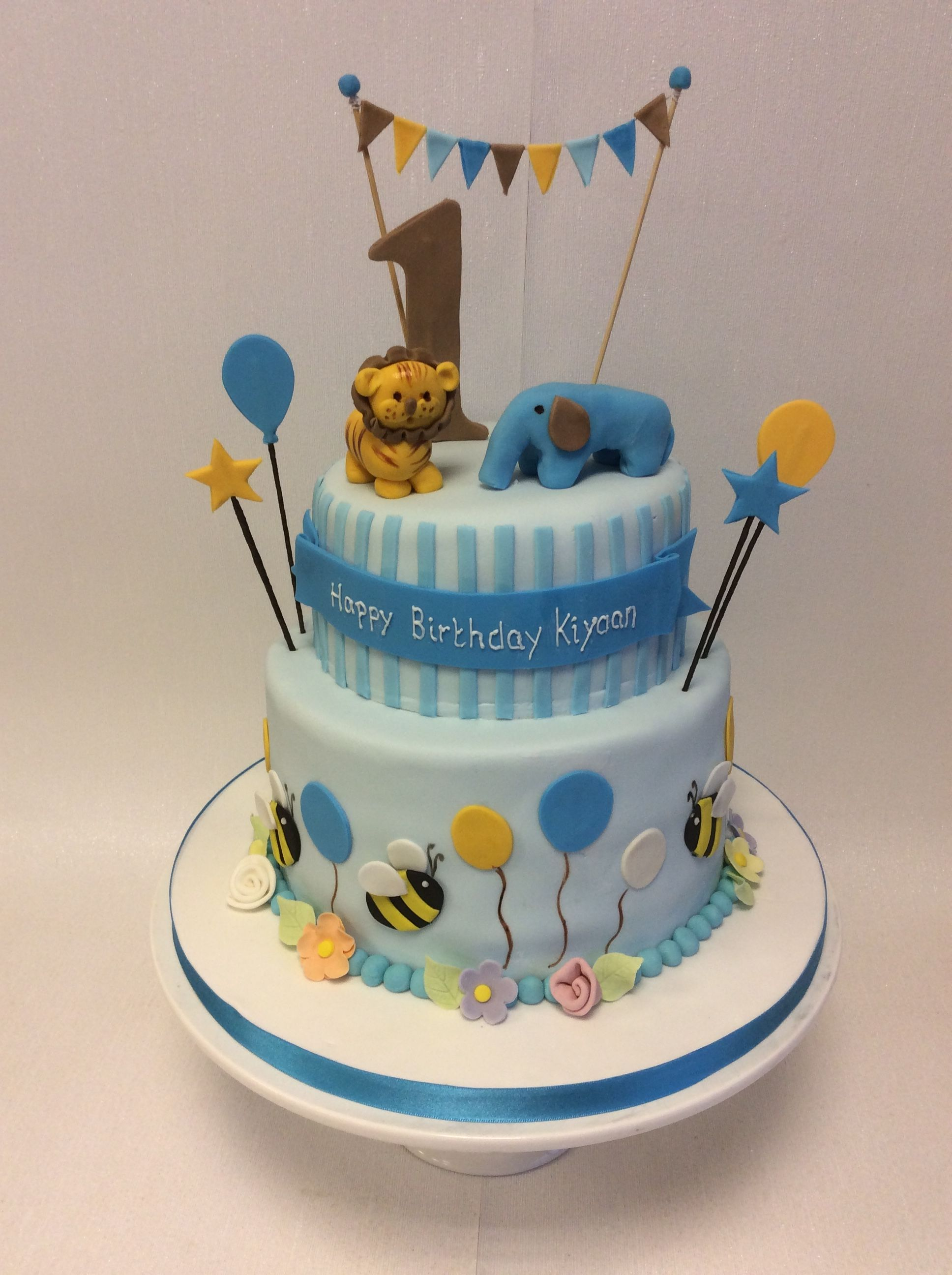 2 Tier 1st Birthday Cake With Animals And Bumble Bees 1st Birthday Cakes Birthday Cake With Candles Boy Birthday Cake Cake designs for boys 1st birthday