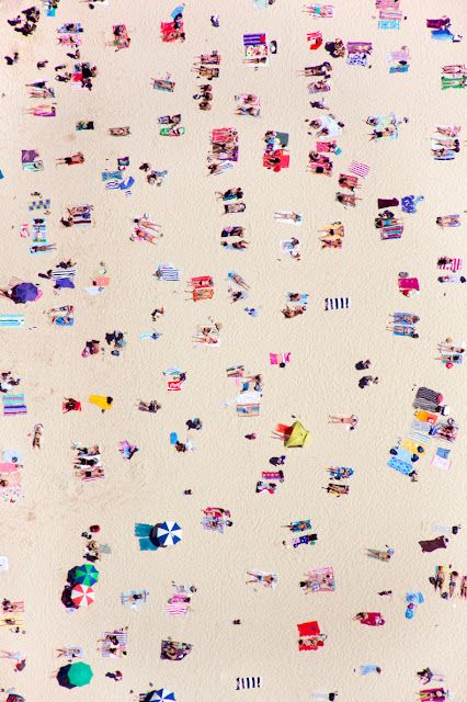photograph by gray malin; looking down at a beach full of people. kn
