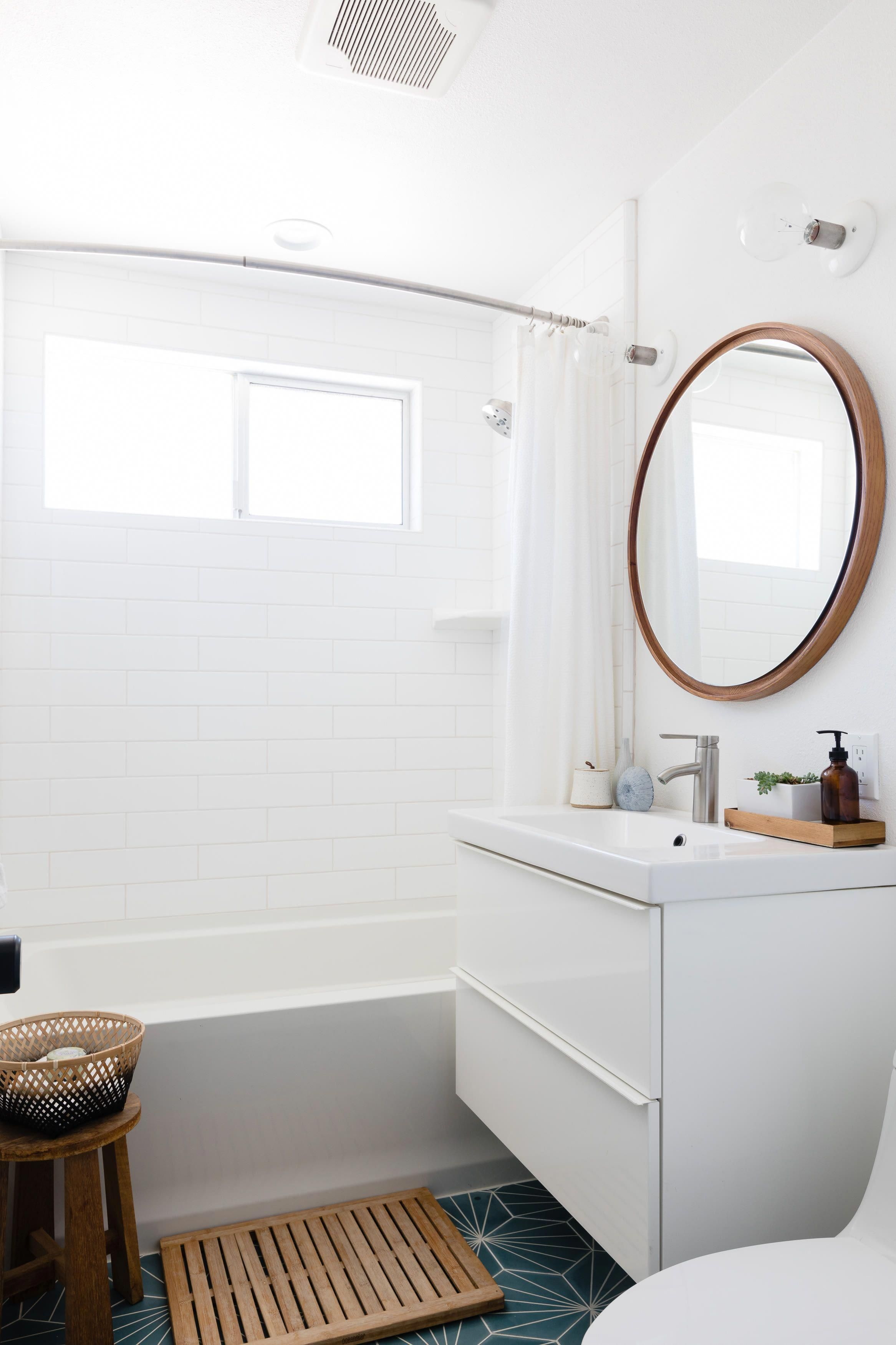 The guest bathroom tile is Marrakech Design's Dandelion pattern. The lighting is Schoolhouse Electric, the mirror West Elm, and the vanity is IKEA's GODMORGON high gloss white with ODENSVIK sink. #bathroommirror #schoolhouseelectric