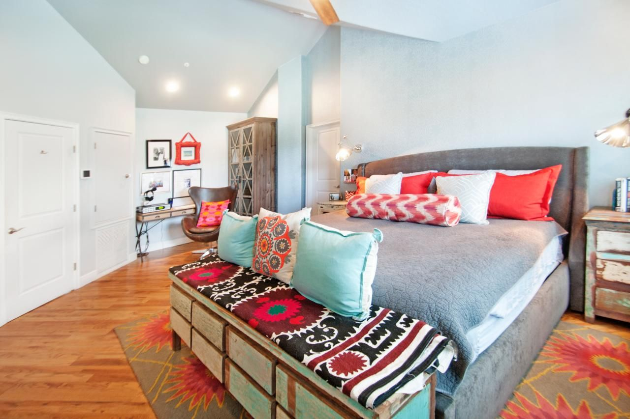 Aqua and coral accents make a bold, colorful statement in this bright, airy  master