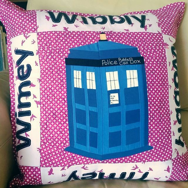 I mass this cushion for my niece who loves Dr. Who everything. Paper-pieced Tardis pattern by Trillium Designs. I designed the cushion with appliquéd words and hand embroidery.