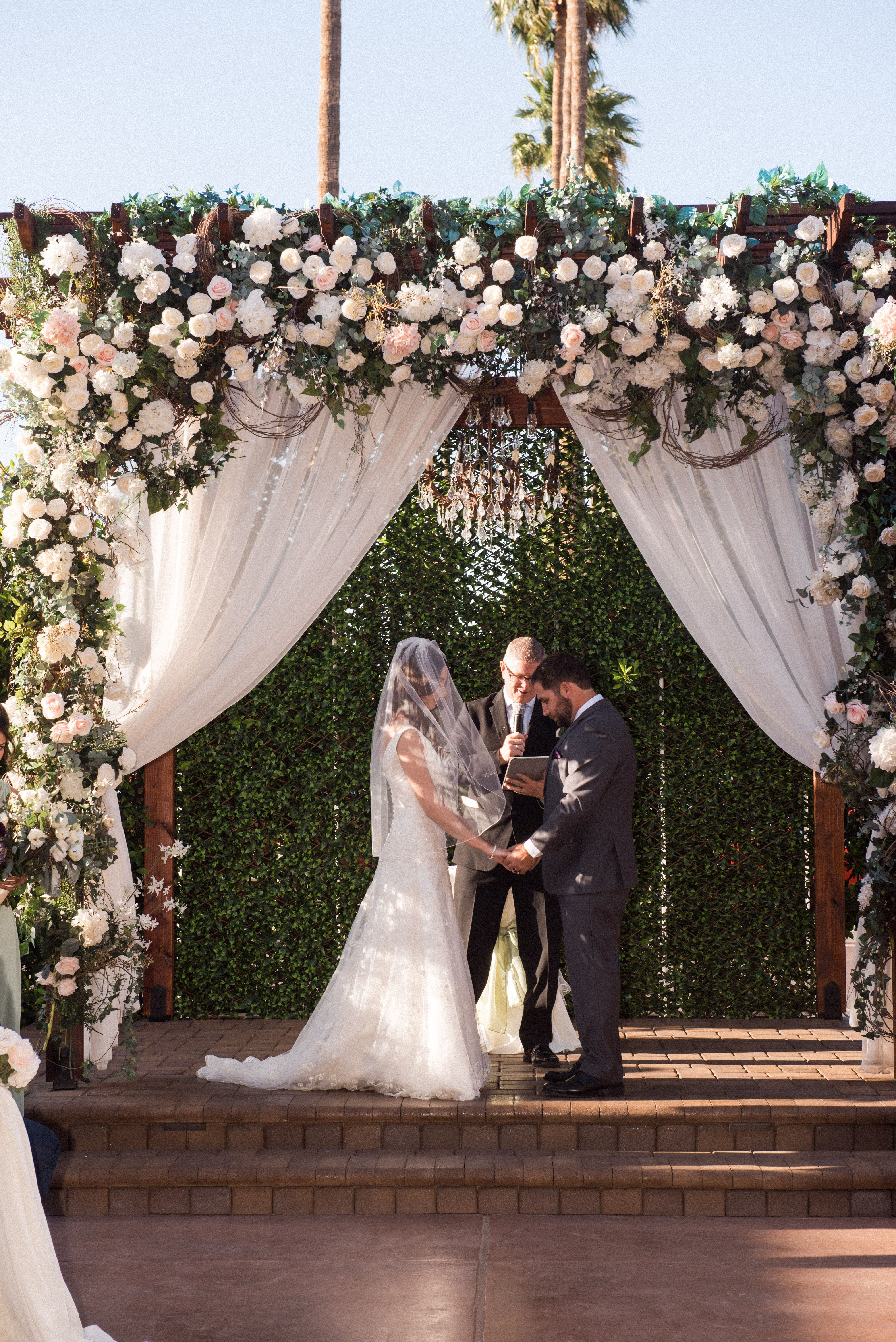 Bride And Groom During Their Outdoor Wedding Ceremony In Our