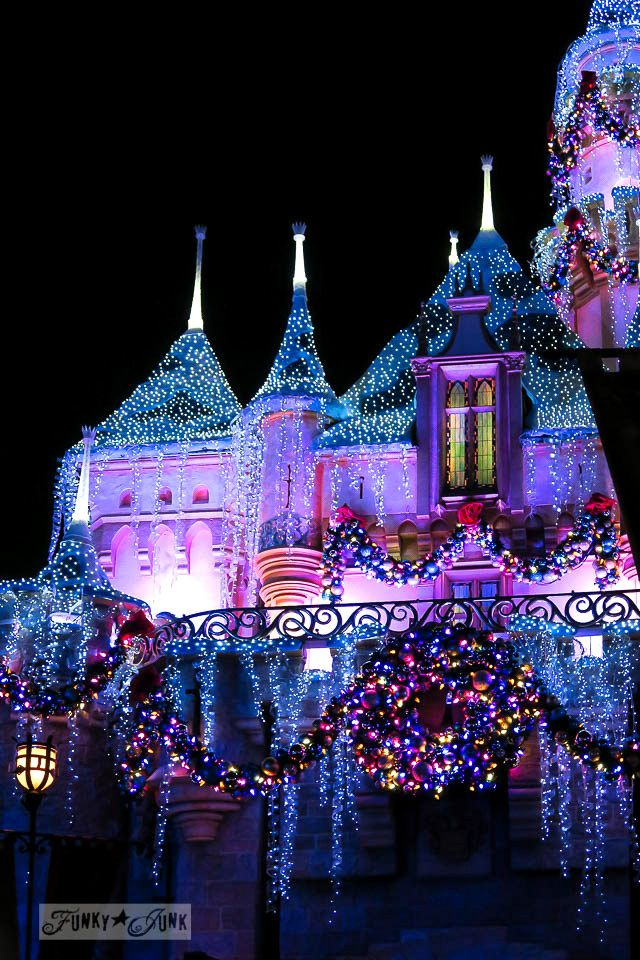 disneyland castle illuminated at night during christmas in disneyland funkyjunkinteriorsnet