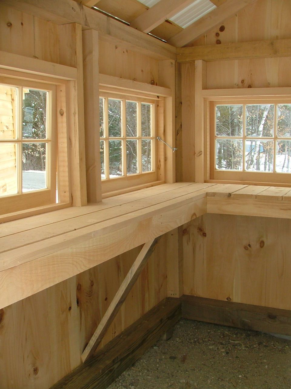 garden shed interior counter work space hinged windows dirt floor