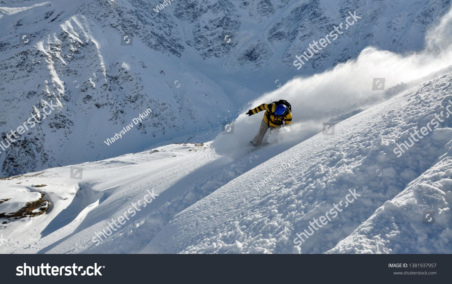 A Skier In The Mountains Rides In The Snow Snowboarder Drives