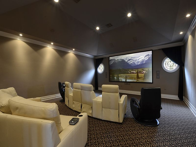 White leather movie chairs flanked by black chairs media