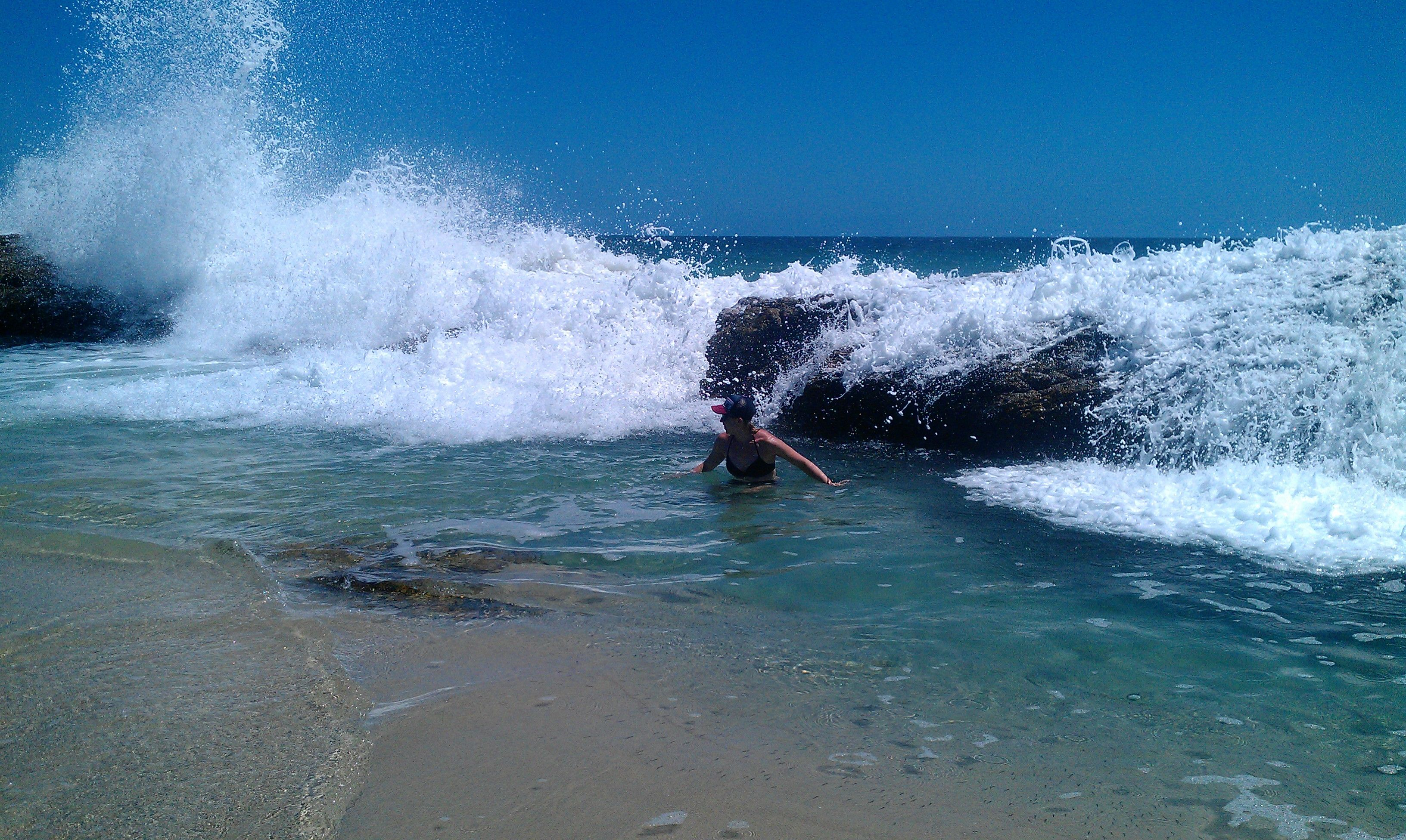 Crystal clear blue water energetically cascades over volcanic rock to then bubble and foam into a series of crystal clear pools. #moretonisland #swimming #beach