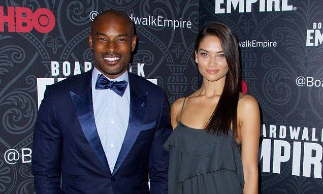 Shanina Shaik and Tyson Beckford hold hands at premiere