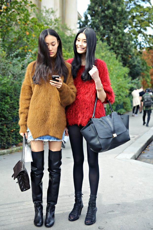 Ming Xi and Shu Pei with their furry jumpers and black legs. #offduty in Paris.