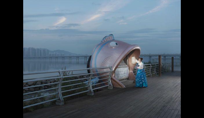 Cultural tradition versus modern city life, Korea 2013 series by Julia Fullerton-Batten. Crisp yet full of symbolism.