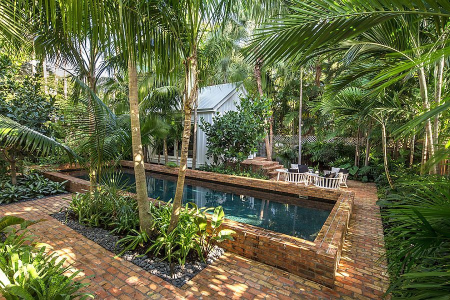 Backyard paradise 25 spectacular tropical pool for Tropical pool gardens