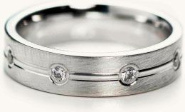 bezel set comfort-fit wedding band in platinum with 0.32ct round brilliant diamonds from T. Anthony Jewelers