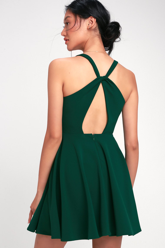 0a5ad8591188a Flirt and twirl in the Lulus Wonder Whirl Dark Green Twist Back Skater Dress!  Skater dress with a surplice bodice and twisted racerback with cutout  detail.