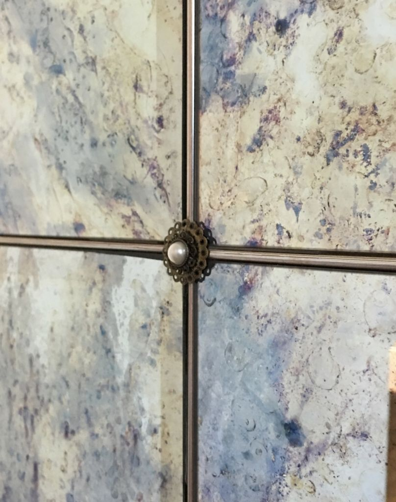Distressed mirrors with aged brass rosettes...Matthew Collins ...