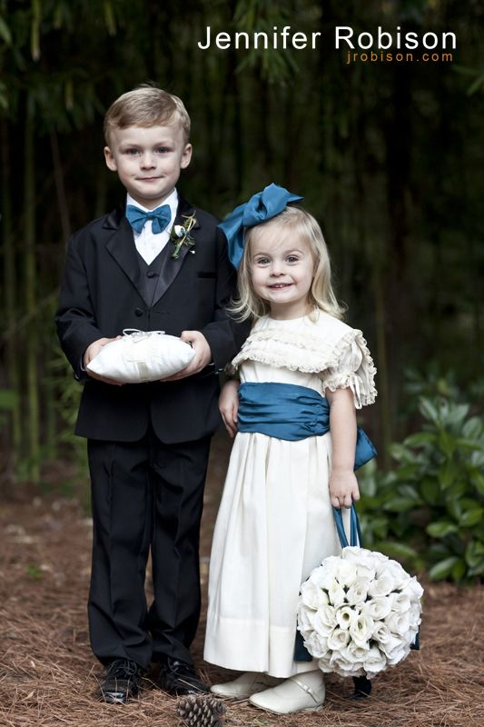 Peacock blue, cream, white wedding. Flower girl wearing dress the bride wore in her older brother's wedding when she was a little girl.