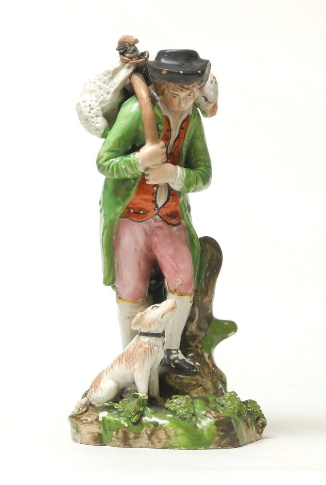 QUALITY ANTIQUE EARLY STAFFORDSHIRE POTTERY PEARLWARE FIGURE, PROB ENOCH WOOD.Measures 7.5 inches/19cm tall.  Its actually in not bad condition at all apart from the scattered enamel flaking, the only bit of loss or damage that I can see is possibly a tiny piece of rope missing between the feet of the sheep to his shoulders, the break to the tree stump to the reverse of the figure is under the original enamel and pearlware glaze so is a manufacturing feature and not later damage.£134