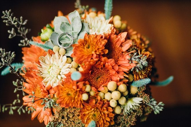Gorgeous fall wedding bouquet... with wedding rings. Image: Oldani Photography