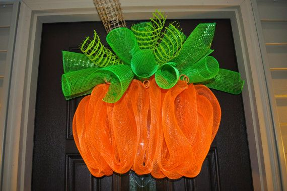 This GORGEOUS Halloween Pumpkin Spiral Wreath is made out of two different types of Deco Mesh; Orange Metallic Deco Mesh, Green Metallic Deco Mesh, Green Jute Mesh, Brown Jute Mesh and features a cute glitter spider.