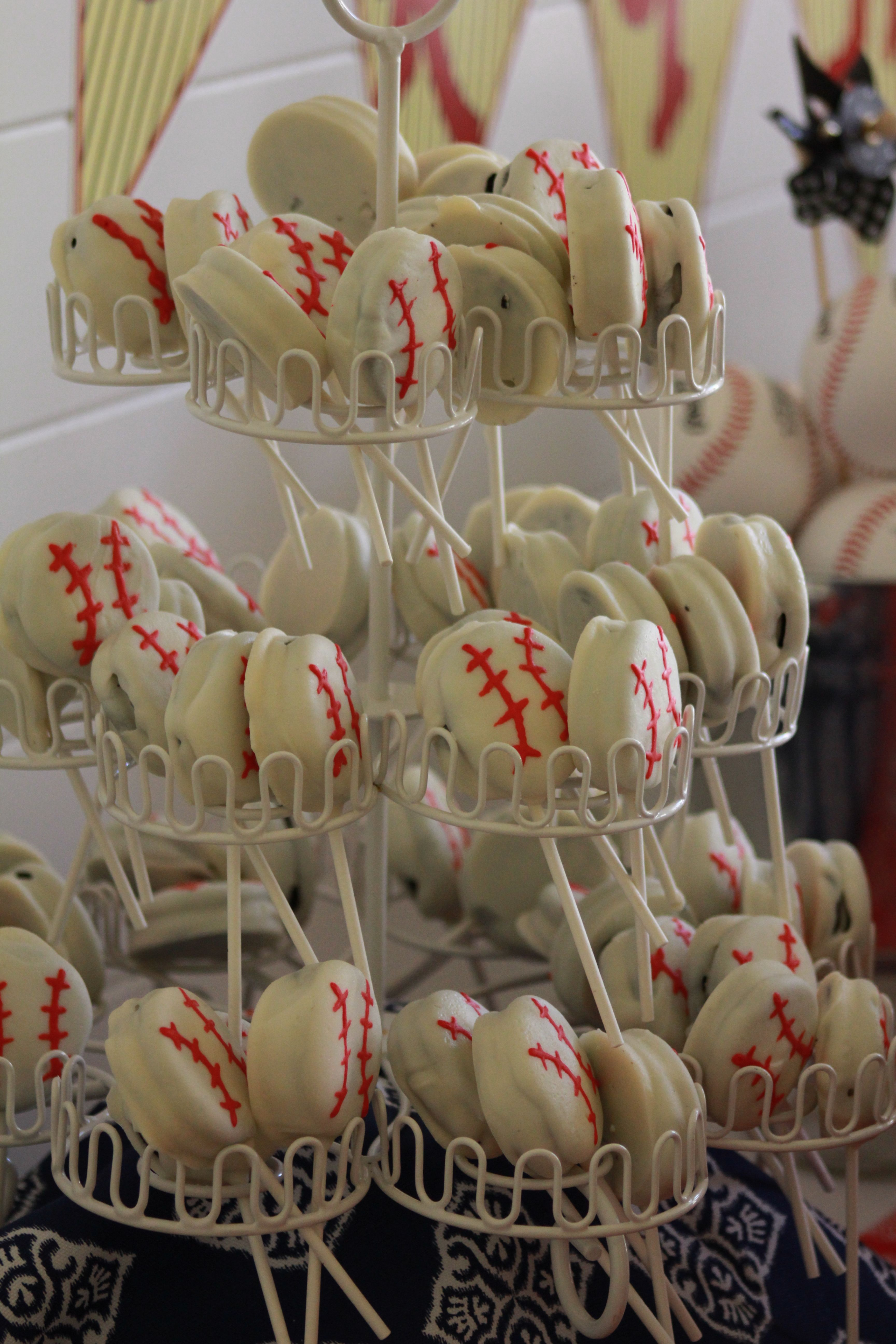 White chocolate covered oreo baseballs perfect for end of season party