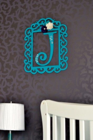 A DIY stenciled nursery accent wall using the Venetian Scroll Stencil from Cutting Edge Stencils. http://www.cuttingedgestencils.com/venetian-scroll-allover-stencil-pattern.html