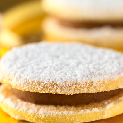 Alfajores are soft, delicate cookies from South America made, with cornstarch. The cornstarch gives the dough a smooth, satiny texture that makes it a dream to work with and produces a tender, crumbly cookie. Creamy�Dulce de Leche�holds the cookies together.�