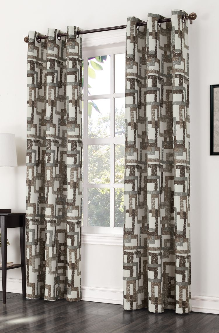 The Kaveri Grommet Curtain features a modern multi color block print on a woven fabric with oil rubbed bronze grommets.  #Grommets #Curtains