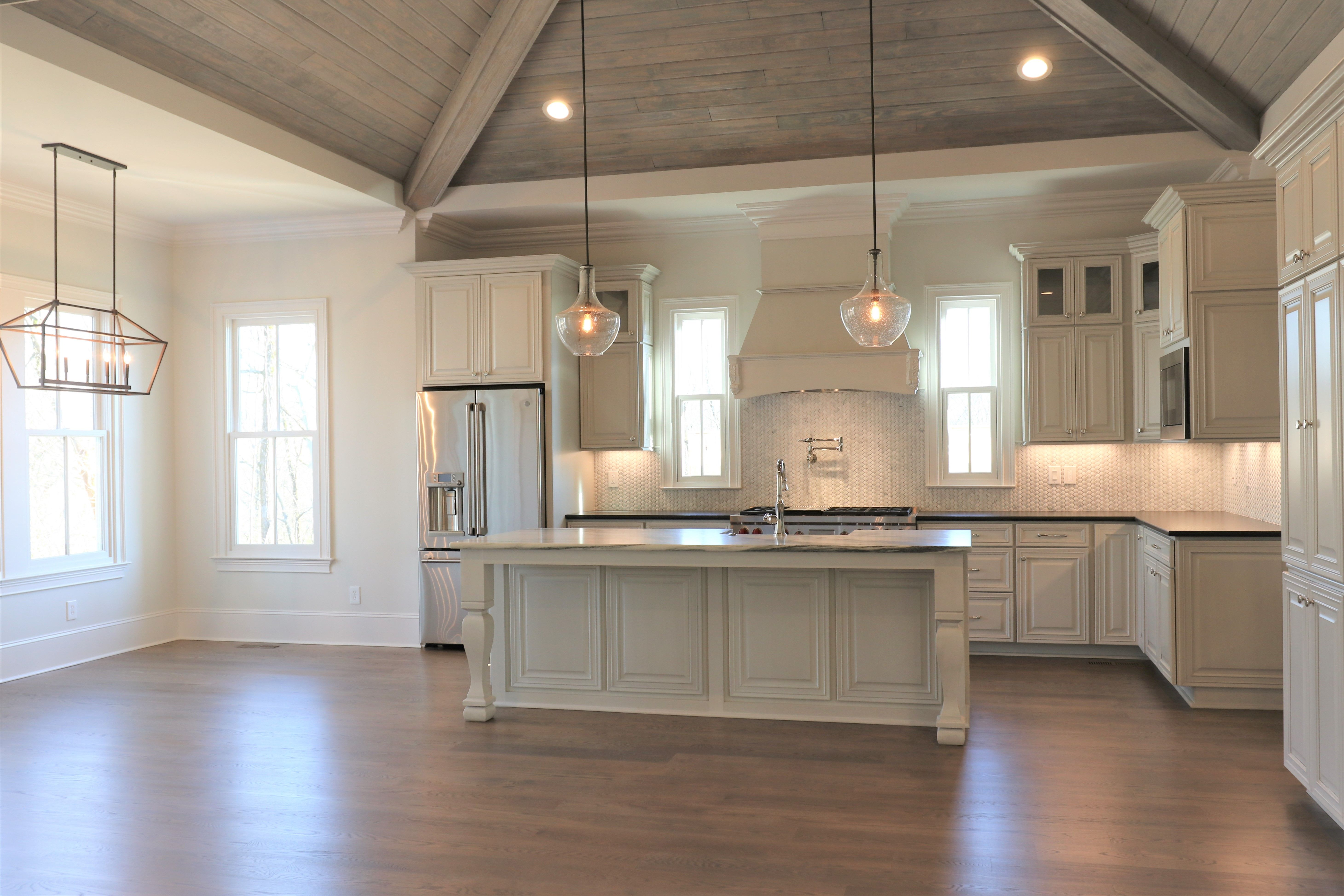 Beautiful Custom Kitchen With Vaulted Ceiling Basket Weave