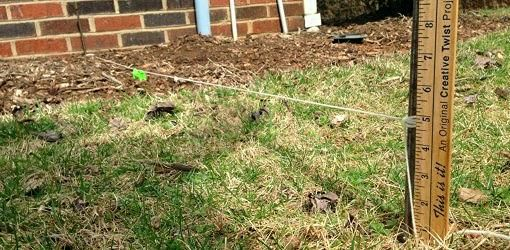 Measuring ground slope from foundation. To ensure proper ...