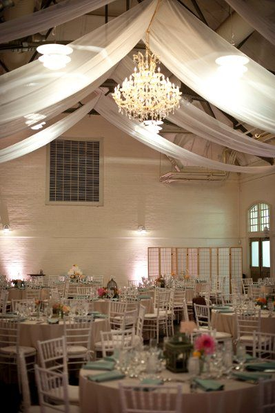 A Beautiful Chandelier In The Center Of The Room Twirly Birds And Bloom Have A Gorgeous Chandy For Rent Venue Decor Wedding Lights Vintage Winter Weddings