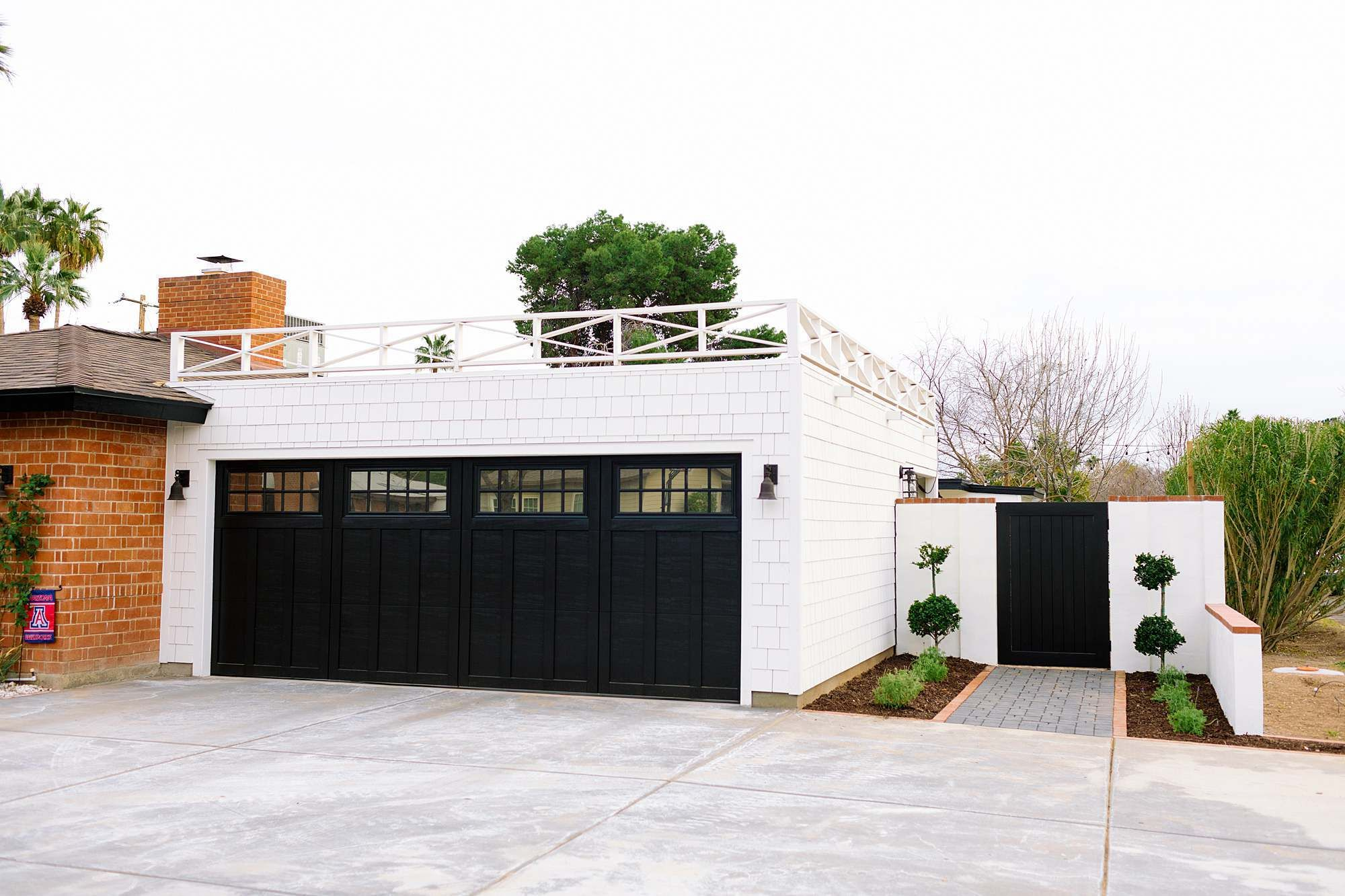 Black And White Garage Expansion Railing On Top Of Flat Roof