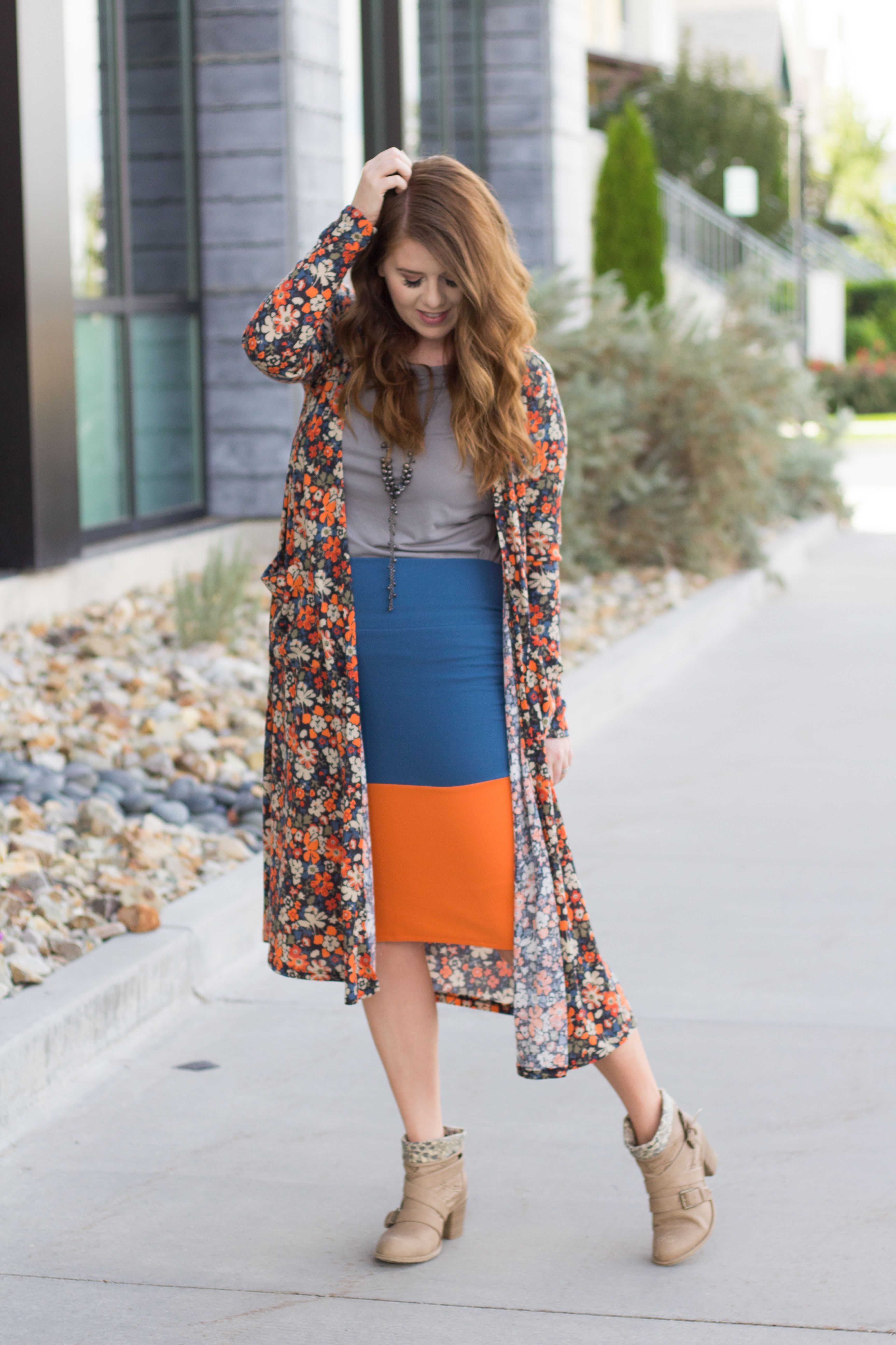 Styling a floral duster cardigan with a color-blocked pencil skirt. I love styling pencil skirts in different ways with different shoe options. This outfit idea is perfect for fall and spring.