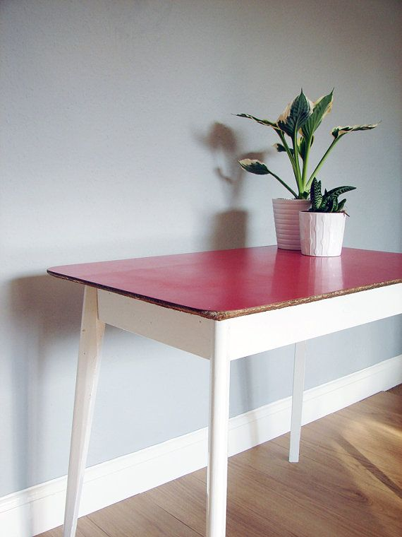 A very retro 1960\u0027s solid wood table with red formica top