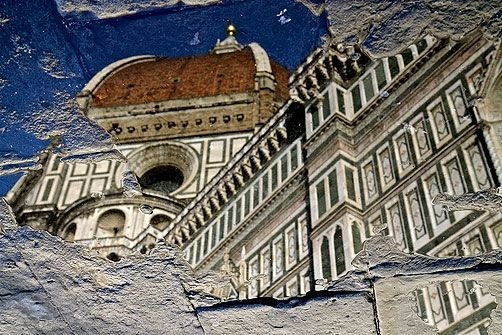 Diane Gorrick. Brunelleschi's dome reflected in broken puddles on the street in Florence.