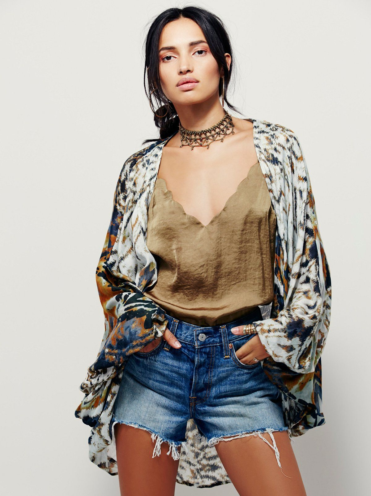 Gemini Drippy Kimono | In a soft and lightweight fabrication, this Western-inspired drippy cocoon kimono features a single button closure in front.