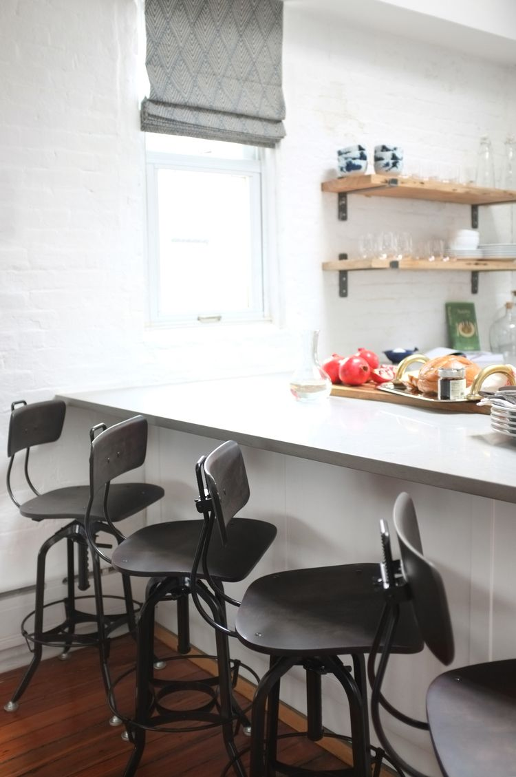 Industrial looking bar stools in kitchen design j and g design