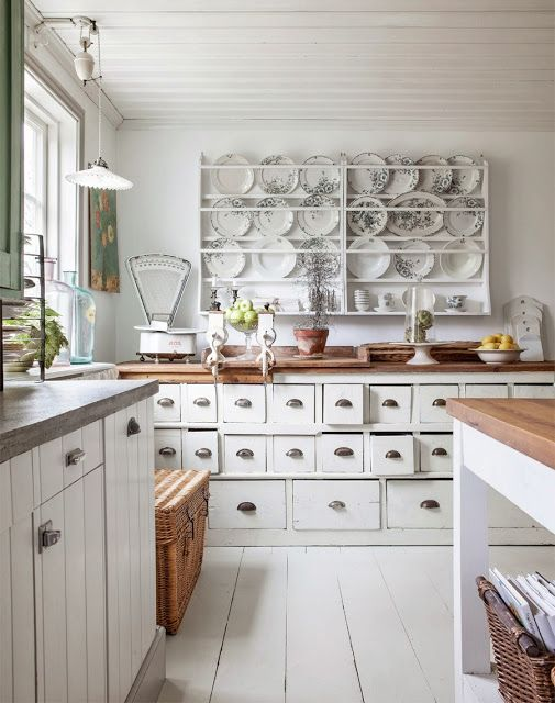 Country kitchen with antique weighing scales and apothecary drawers