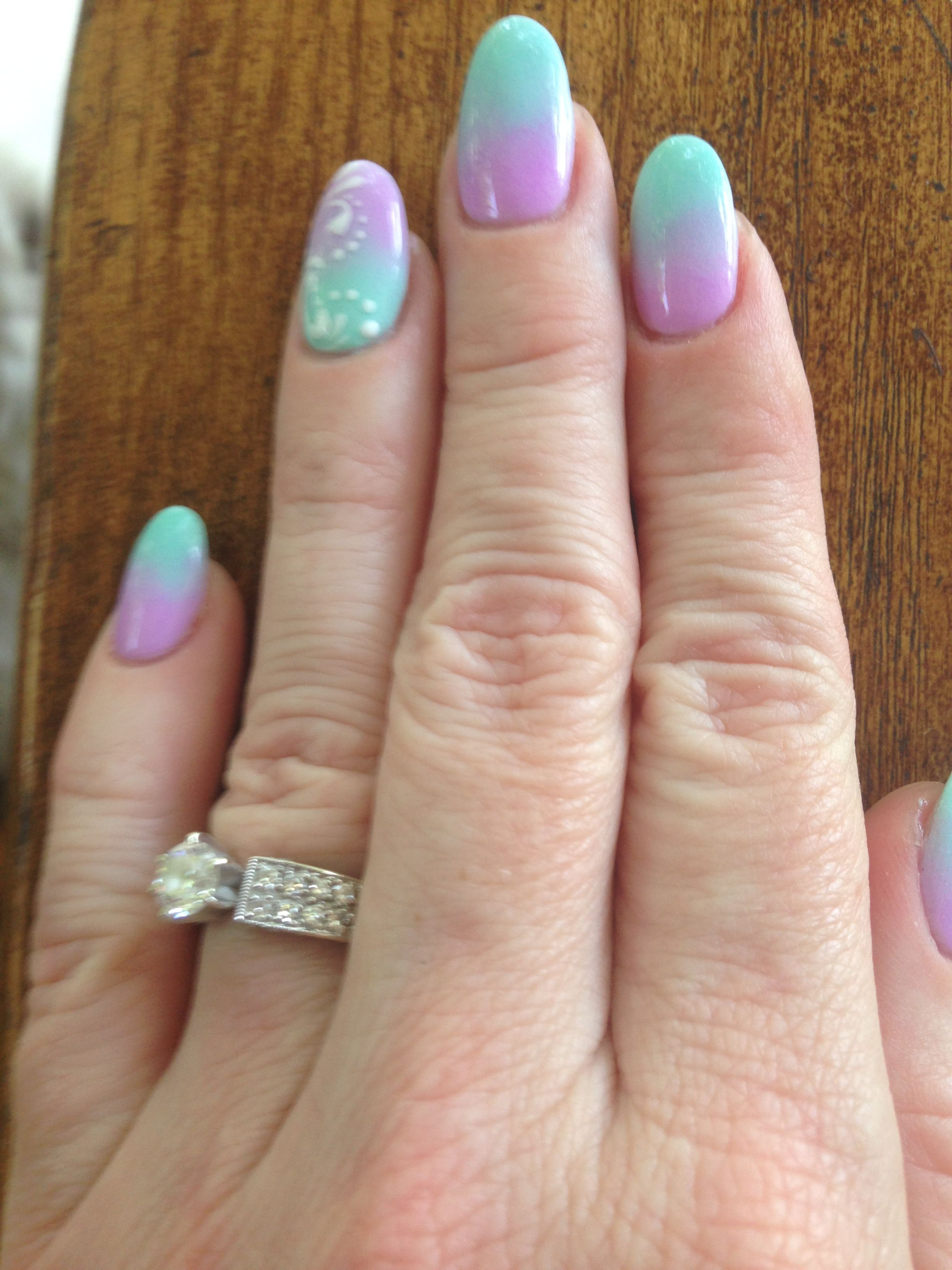 Dipping powder ombré nails teal and lilac with a white swirl design ...