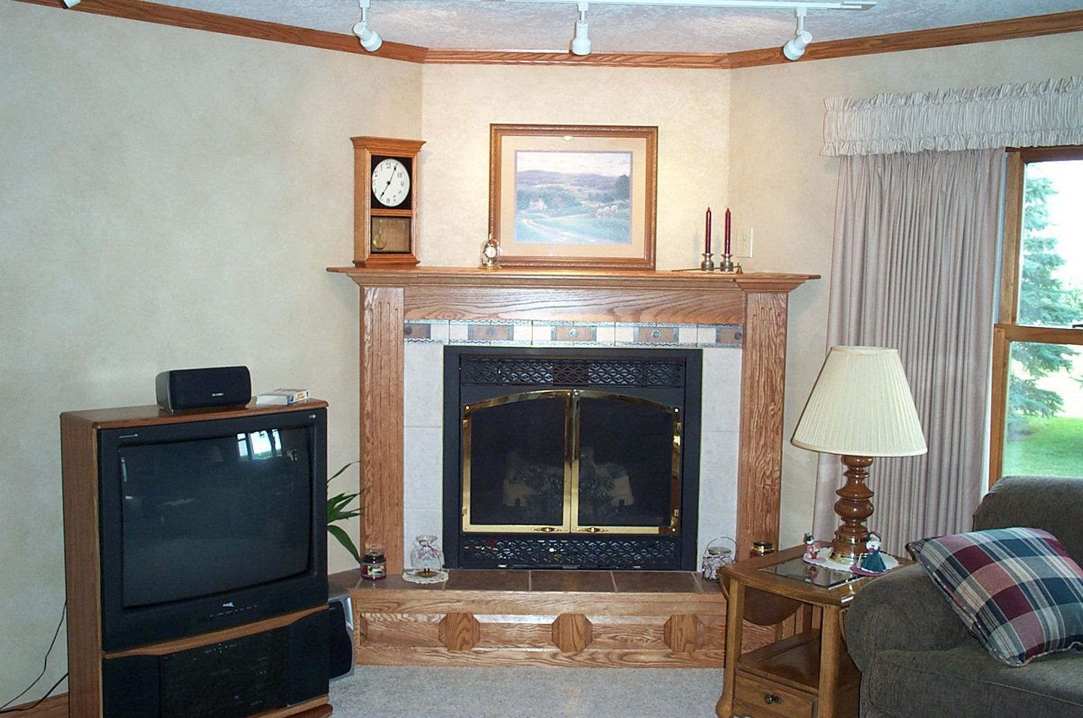 wood corner fireplace with tile and picture above in 2020 ...