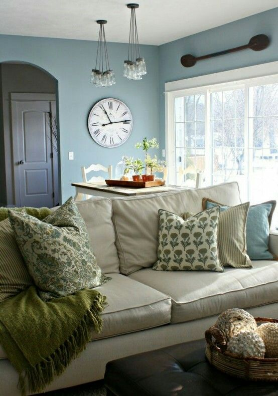Light Slate Blue Walls Simple Decor Light Tan Couch Green And Blue Pillows And Throw Farm House Living Room Living Room Colors Modern Farmhouse Living Room