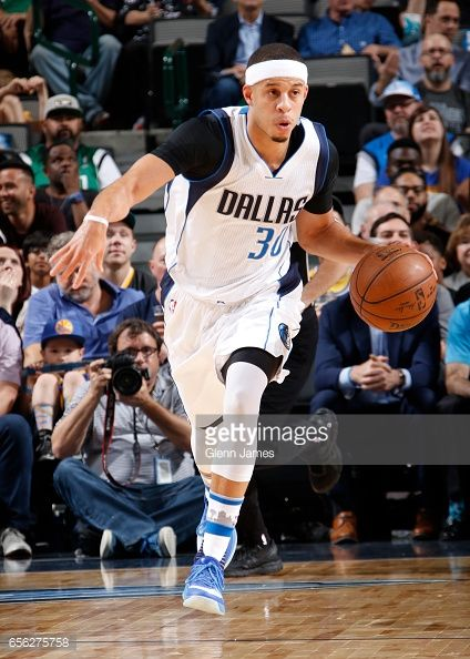 News Photo : Seth Curry of the Dallas Mavericks brings the...