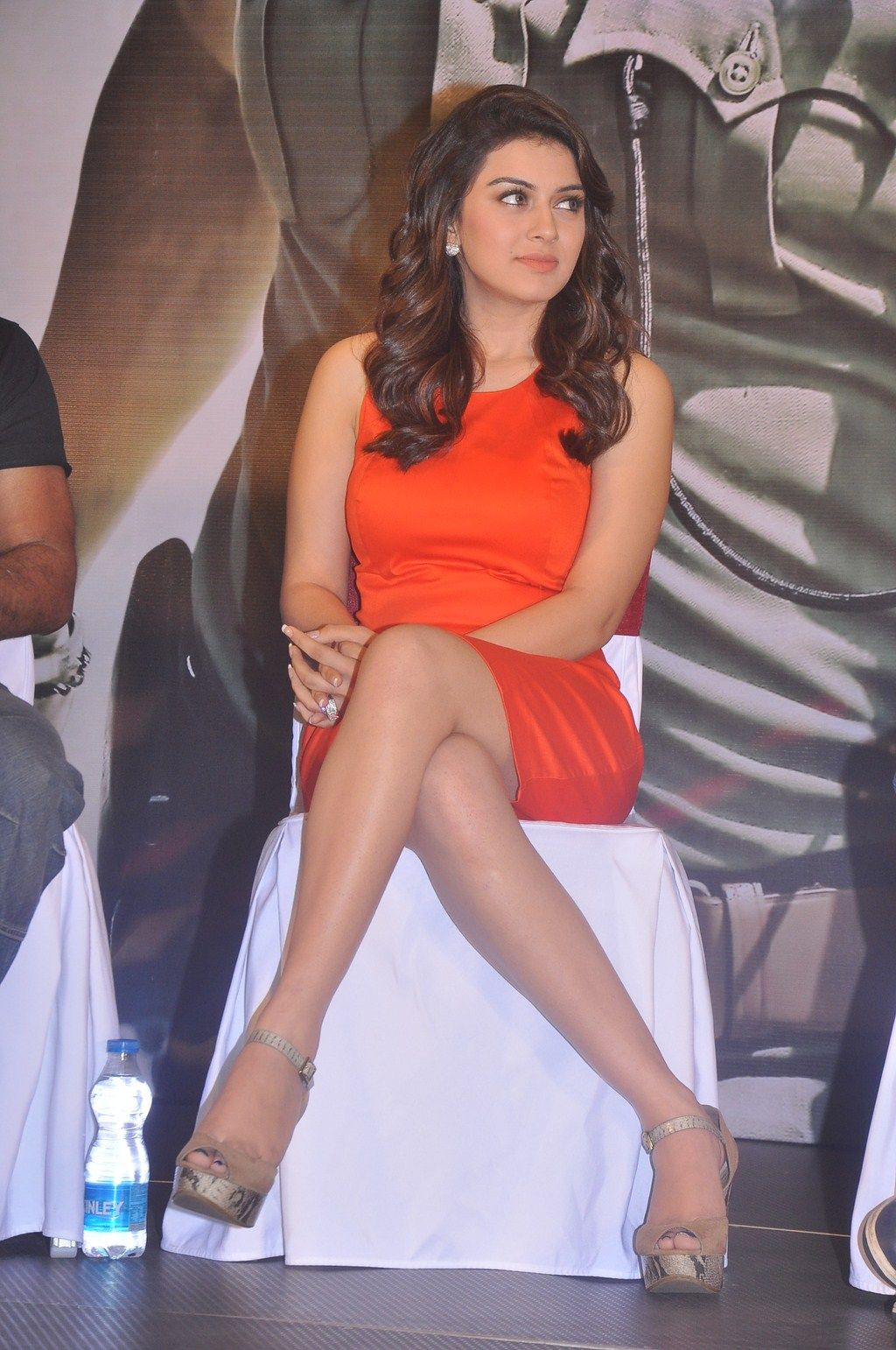 hansika motwani in orange dress at singam 2 tamil movie press meet