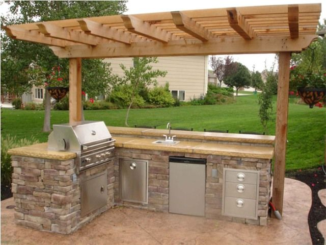 Outdoor kitchen designs because the words outdoor for Outdoor grill cabinet plans