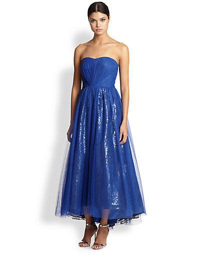 ML Monique Lhuillier Strapless Tulle-Sequin Gown A tulle overlay elevates this sequined gown, creating a voluminous special-occasion-worthy style featuring pleating at the bodice and waist.